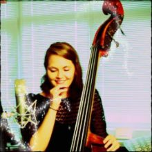 Kate Davis smiling with her upright bass